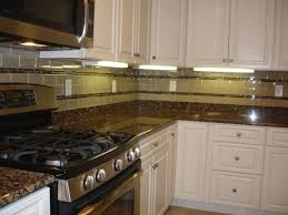 nice kitchen backsplash white cabinets brown countertop with