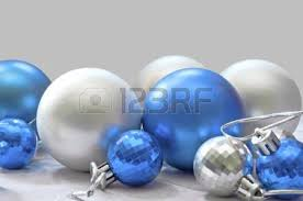 blue and silver balls on the snow blurry background