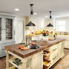 country style kitchen island ok i m warming up to the idea of a butcher block top for the island