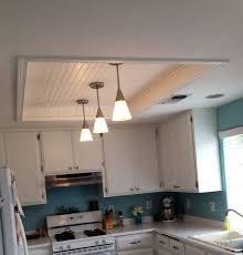 kitchen ceiling fluorescent light fixtures kitchen fluorescent light box remodel with wood beadboard ceiling