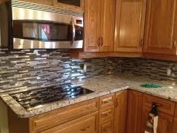 giallo ornamental granite with a mosaic backsplash granite