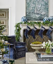 day 29 blue christmas traditional home in their christmas decorating was merely a natural extension of their home s year round palette their composite stone mantel features blue velvet