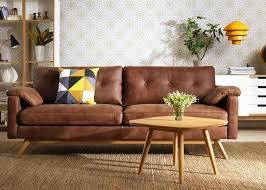 canap brun canapé en cuir brun cognac tableau plancher blanc de basse en bois
