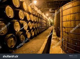 Wine Cellars Porto - old barrels wine cellar porto portugal stock photo 417729238