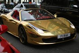 pictures of ferraris gold heads fleet of sports cars taking the