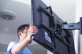 installing wall mount tv installing mount tv on the wall at home or office stock photo