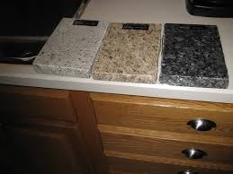 golden oak kitchen cabinets with black countertops granite with