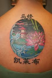 asian letters and flowers tattoo on upper sleeve tattooshunter com