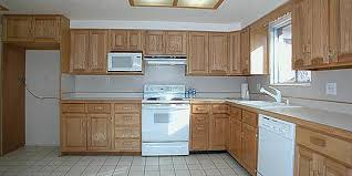 painting kitchen cabinets from wood to white painting kitchen cabinets before after