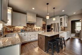 flooring kitchens with white cabinets also black bar stools also