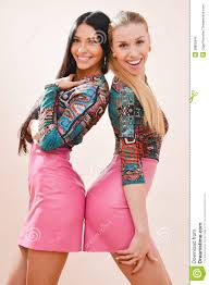 portrait of two young beautiful women blonde u0026 brunette with long