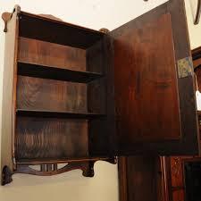 an art nouveau mahogany hanging wall cabinet wall mounted