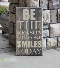 be the reason someone smiles today quote saying wood sign