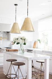 best images about kitchens pinterest countertops just few gold and bronze accents this adds instant elegance sparkle simply appointed with brass pot filler faucet pendant lights stools