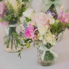 wedding flowers jam jars exles of beautiful cake flowers hair circlets table flowers