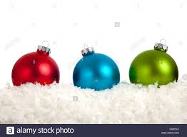 blue and green ornaments on a white background with