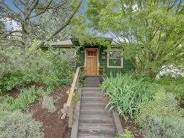 gorgeous green bungalow by the dekum triangle