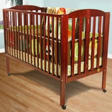 dream on me full size 2 in 1 convertible folding crib in cherry