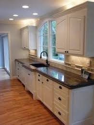 brown granite countertops with white cabinets brown granite in a beautiful white kitchen in a model home in