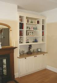 bespoke alcove cabinet with fitted dresser style bookshelves unit