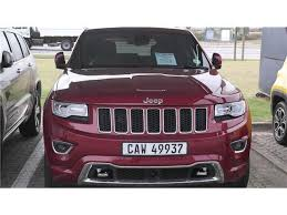 red jeep cherokee red jeep grand cherokee 3 0 crd overland at with 6500km available