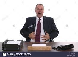 Customer Help Desk Businessman Sat Behind A Desk Laughing Concept Of Helpdesk