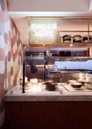 restaurant kitchen furniture ash nyc adds pops of pink to dig inn boston restaurant