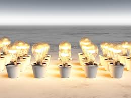 rows of light bulbs with warm light royalty free stock images