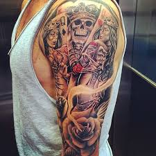 awesome detailed and designed queen cards tattoo on half sleeve