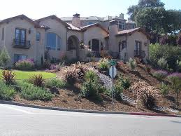 hillside landscaping with rocks and waterfall front yard
