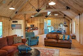 barn home features open living space with a 3 car garage below