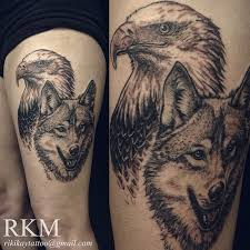 wolf and eagle thigh tattoos wolf eagle and
