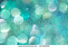 aqua blue iridescent confetti glitter abstract stock photo