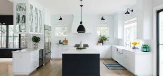 two tone kitchen cabinets with black countertops 25 black white kitchen cabinet ideas sebring design build