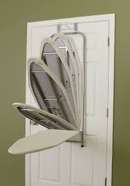 ironing board holder wall mount 20 great space saving ideas for doors living in a shoebox
