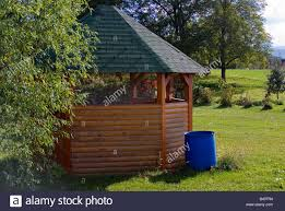 wooden garden hut in shape of octagon stock photo royalty free