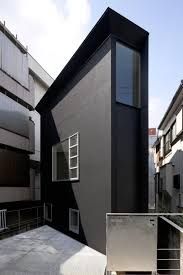 Narrow House Designs by Fort Like House Design Partially Submerged Twin Narrow Structures