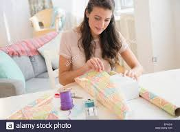 woman wrapping present stock photo royalty free image 82936254