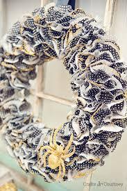 spooky cupcake liner halloween wreath mod podge rocks