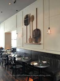 restaurant no 246 handblown lightbulbs pizza paddles wall