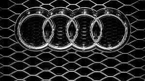 audi emblem on a grille metal logo wallpaper wallpaper download