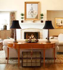 coral console table family room traditional with window treatments