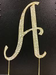 gold monogram cake toppers rhinestone covered gold monogram wedding cake