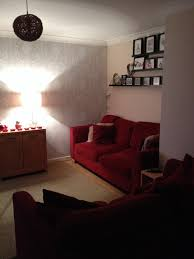 what colour paint and accessories should i use with my red sofas and n