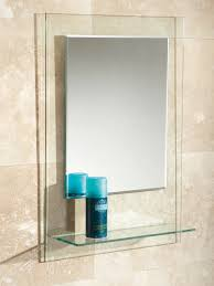 fuzion bevelled edge mirror on clear glass with glass shelf