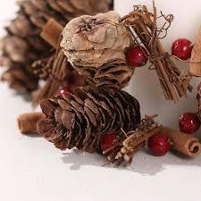 pine cones twigs cinnamon sticks with berries garland