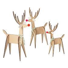 three wooden reindeer decorations blue windows