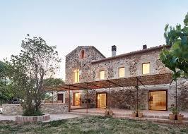 arquitectura g renovates spanish farmhouse with glazed tiles