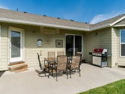 ranch style single level home with a gas grill big backyard