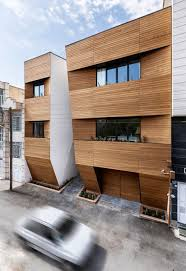 afsharian u0027s house by rena design has vertical slice in facade